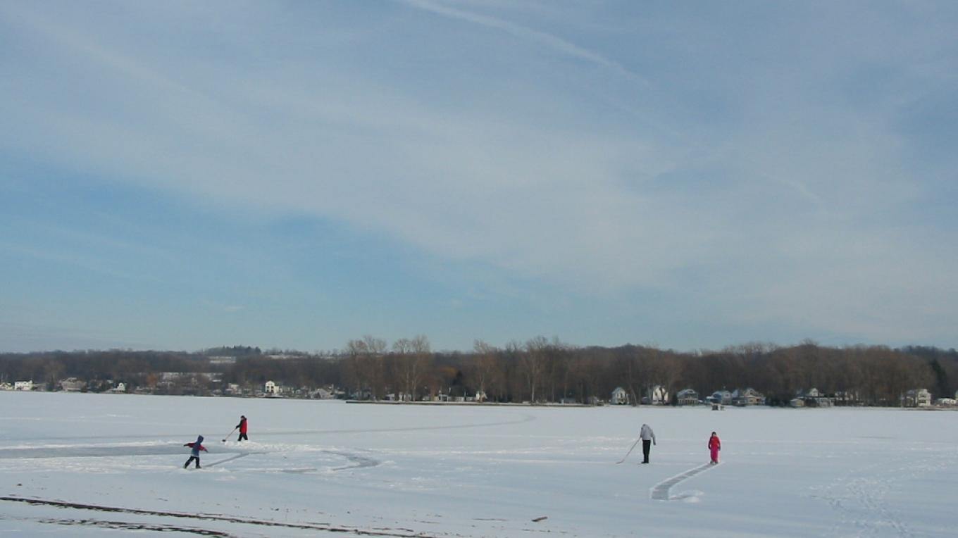 A family ice hockey game developing by Long Point Park, Town of Geneseo