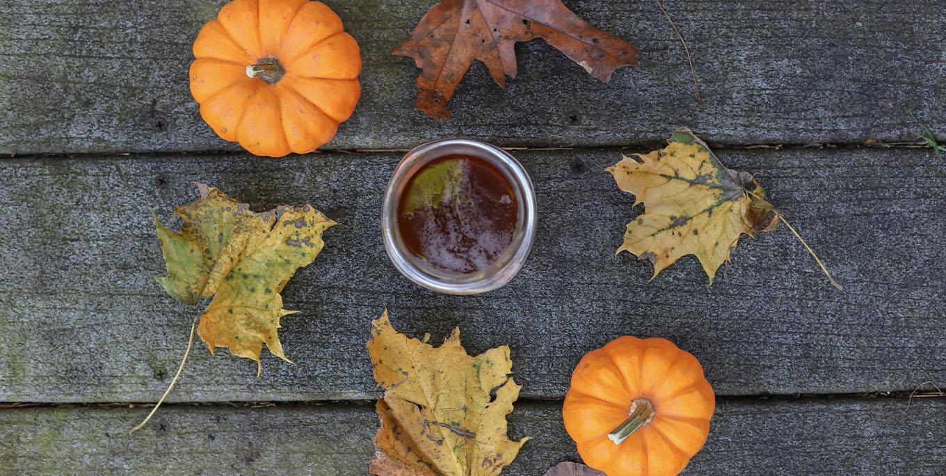 Pumpkins and leaves around the maple porter at Dublin Corners Farm Brewery. Photo by Sarah Gualtieri.