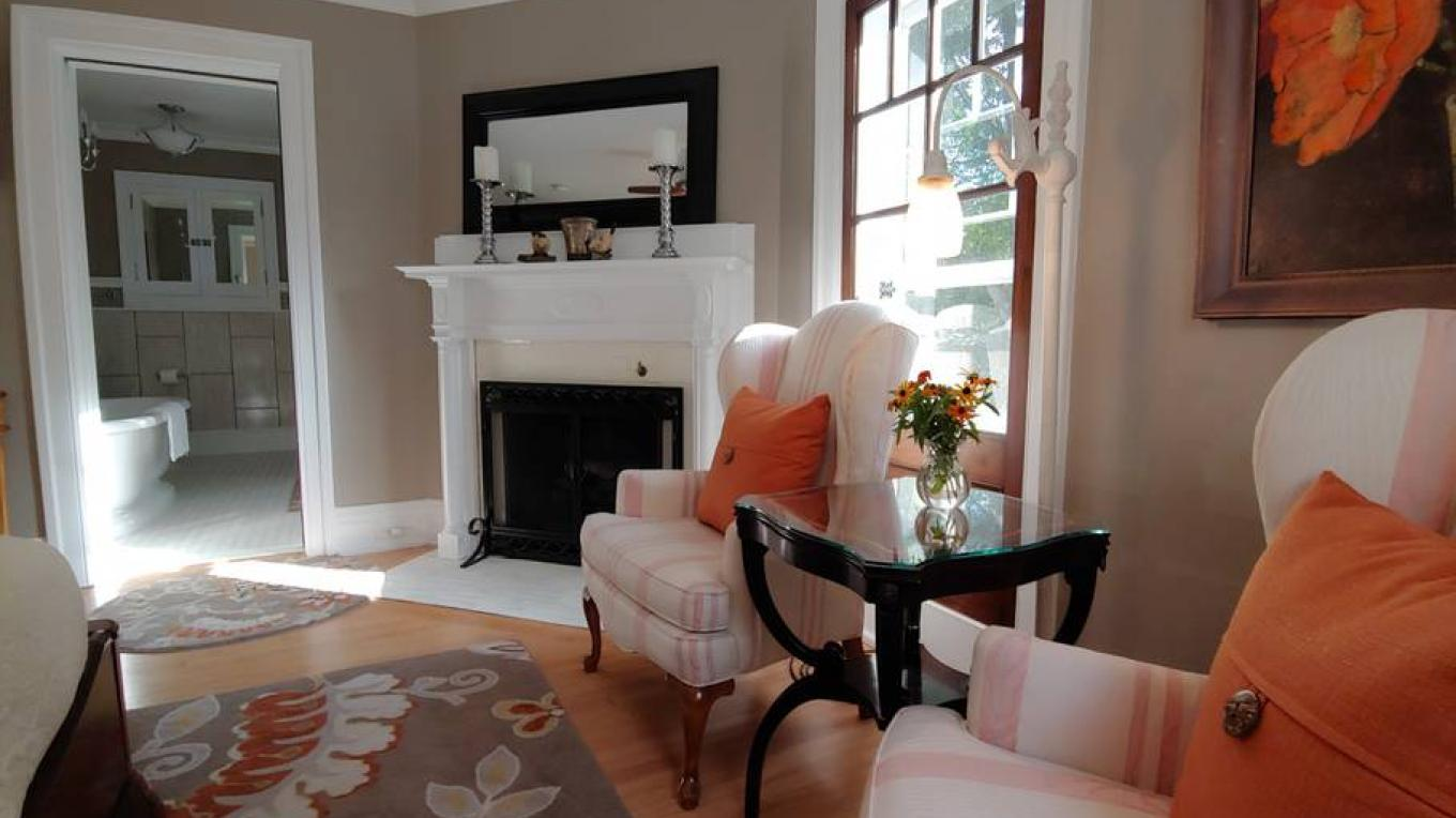 Seating area and cozy fireplace, the Sparrow Guest Room