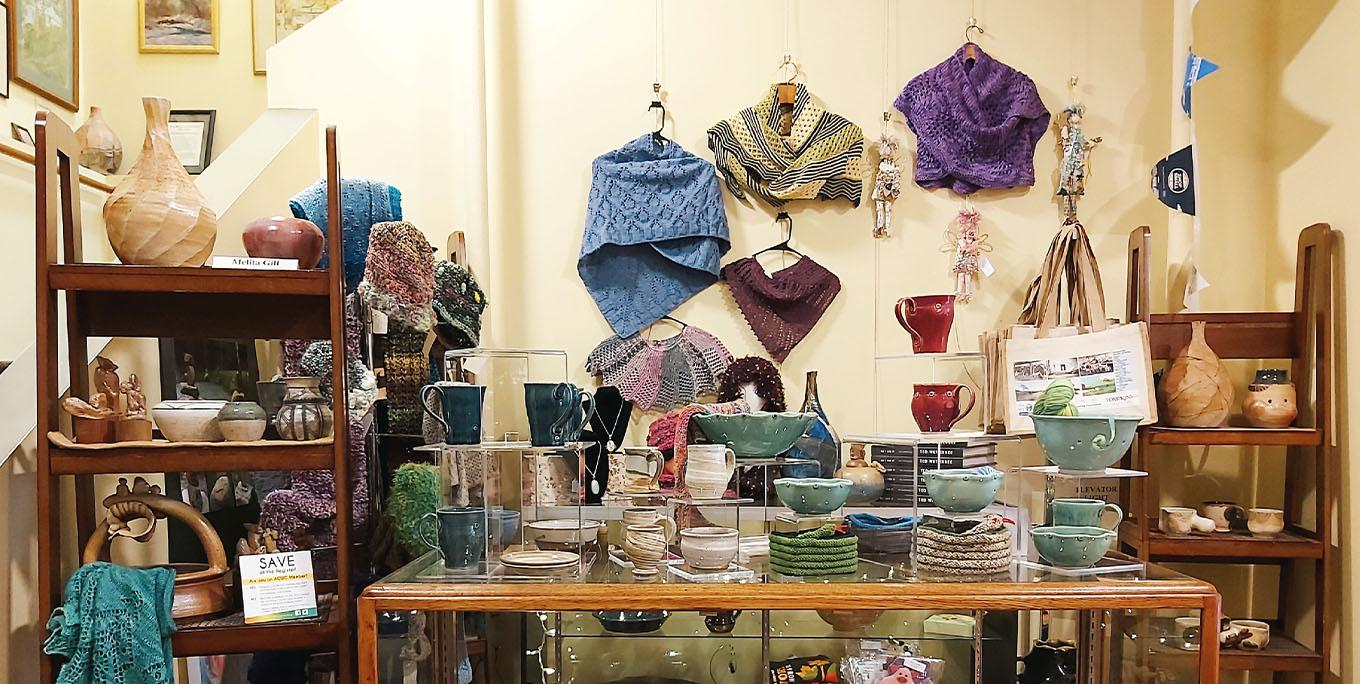 Arts Council gift shop, picture featuring pottery and shawls. Photo by Jackie Hoyt.