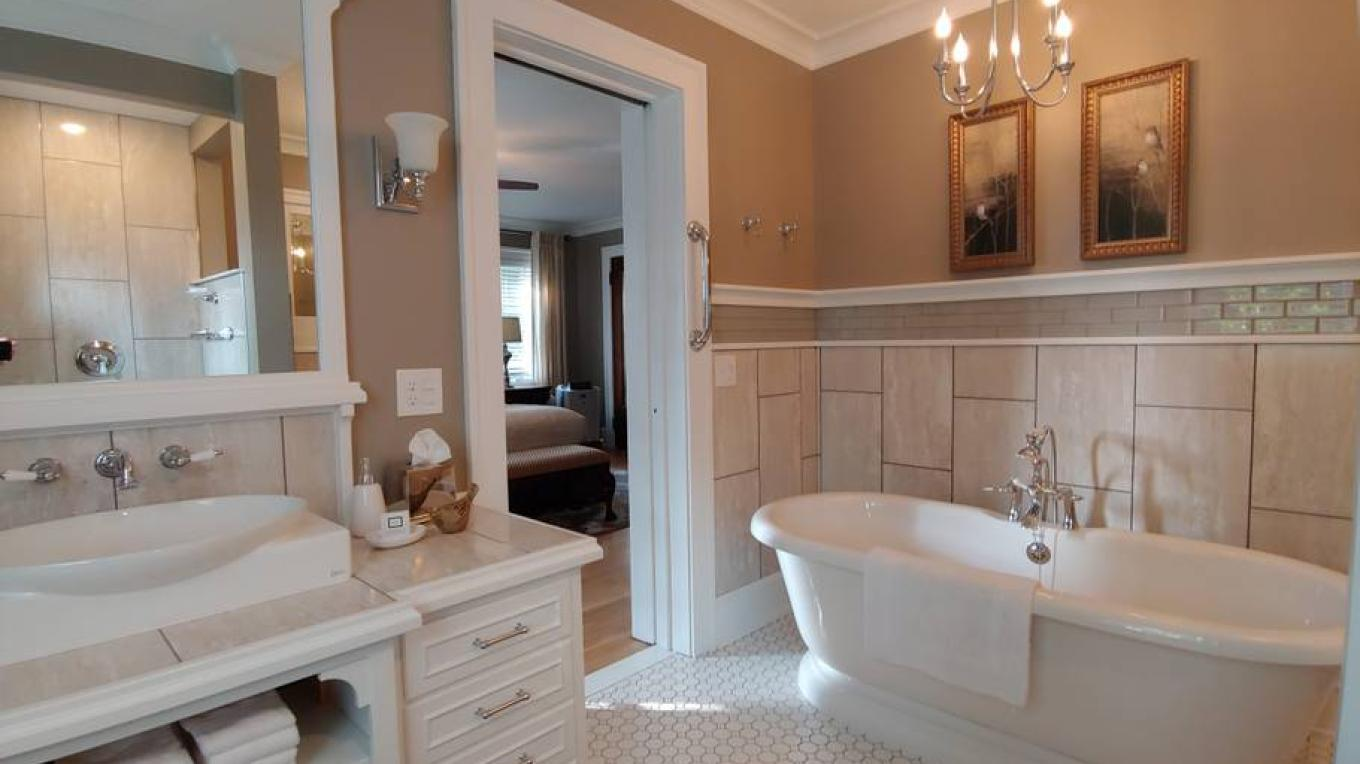 Unwind in the deep relaxing Soaker Tub just a step from your bedroom