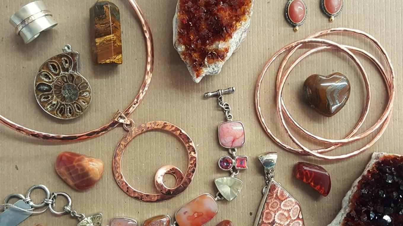 A beautiful display of jewelry from Touch of Grayce in copper, sterling silver, semi-precious and precious gemstones. Hand-selected & beautifully displayed. Featuring citrine, tigers eye, fire agate & more.