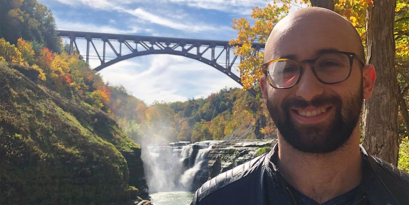 Jon Kanelstein in front of the Upper Falls at Letchworth State Park. Photo by Sarah Keeler.