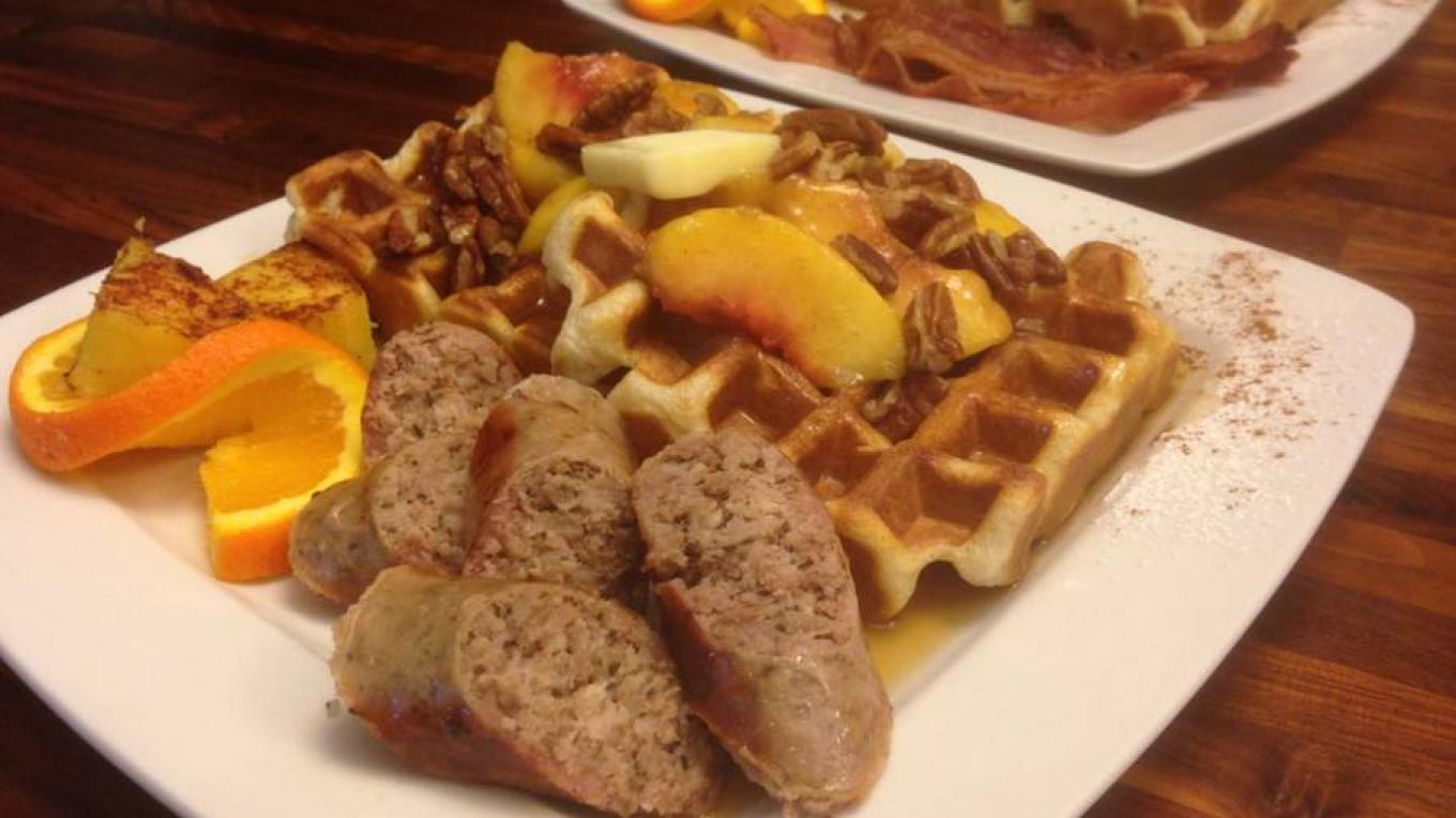 Buttermilk waffles smothered in glazed peaches, pecans and local maple syrup. Served with a side of farm raised 4H pork sausage or smoked bacon.