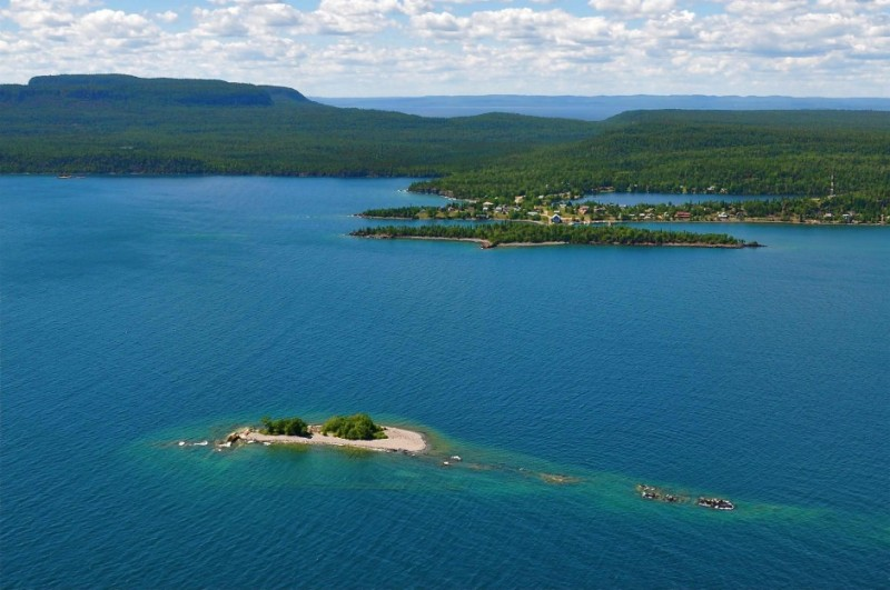 The scenic landscape of Lake Superior flying over Silver Islet, the abandoned silver mine from the late 1800s at the tip of the Sleeping Giant. – Monica Prelle