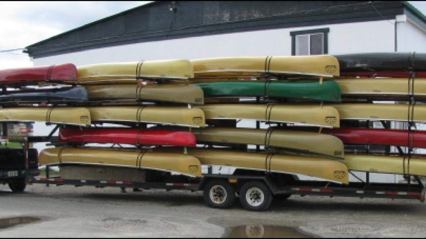 A load of completed canoes ready to ship out across Canada and the US! – Souris River Canoes