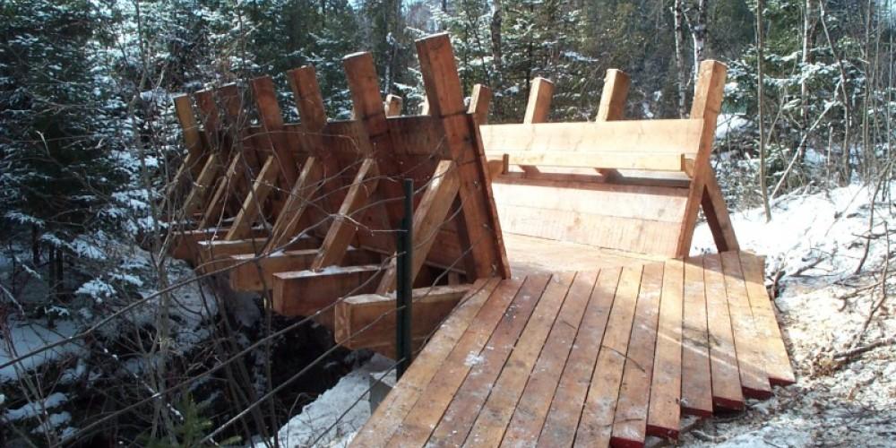 High Falls Trail foot bridge replication of the original log shute