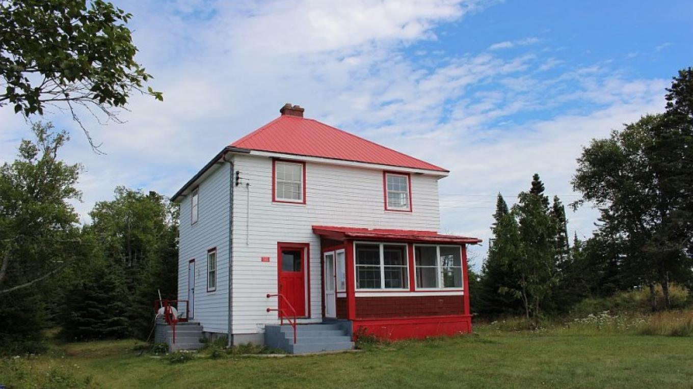 The lighthouse keeper's house is a two-story three bedroom building, that guests to the island are welcome to rent for an overnight stay. – Photo by: S. Reid
