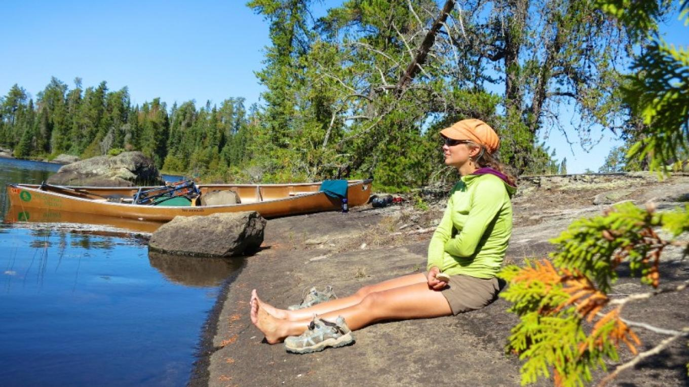 Trail guide Sarah Oppelt stares off into the lake in the BWCA. – P. Musegades