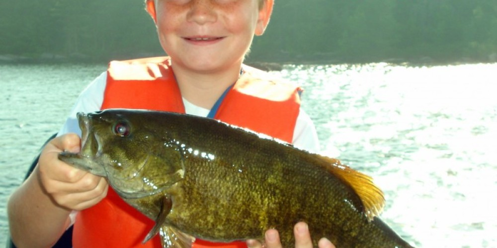 kids having a great time catching fishi – Tom Pearson