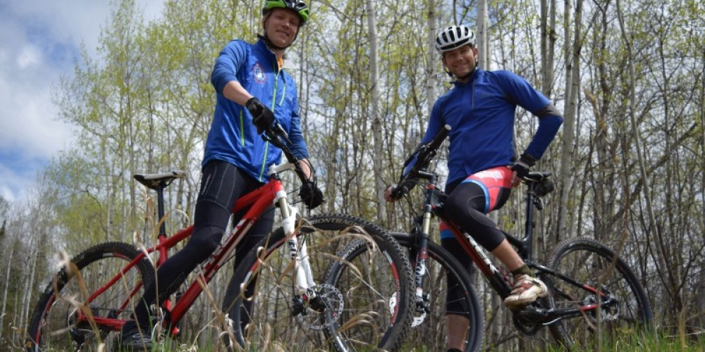 Co-owners/ Head Guides Matti Erpestad and Jake Boyce on mountain bikes – Laura Francis