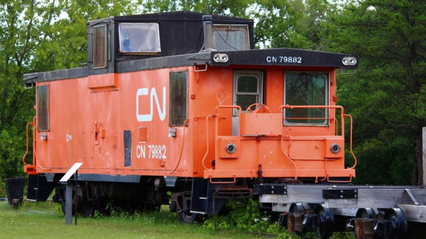 Canadian National Caboose #79882 was built in Point St. Charles Shop, Montreal, entering into service on main and secondary rail lines in 1977 – Lynx Photography (Doug Strom)