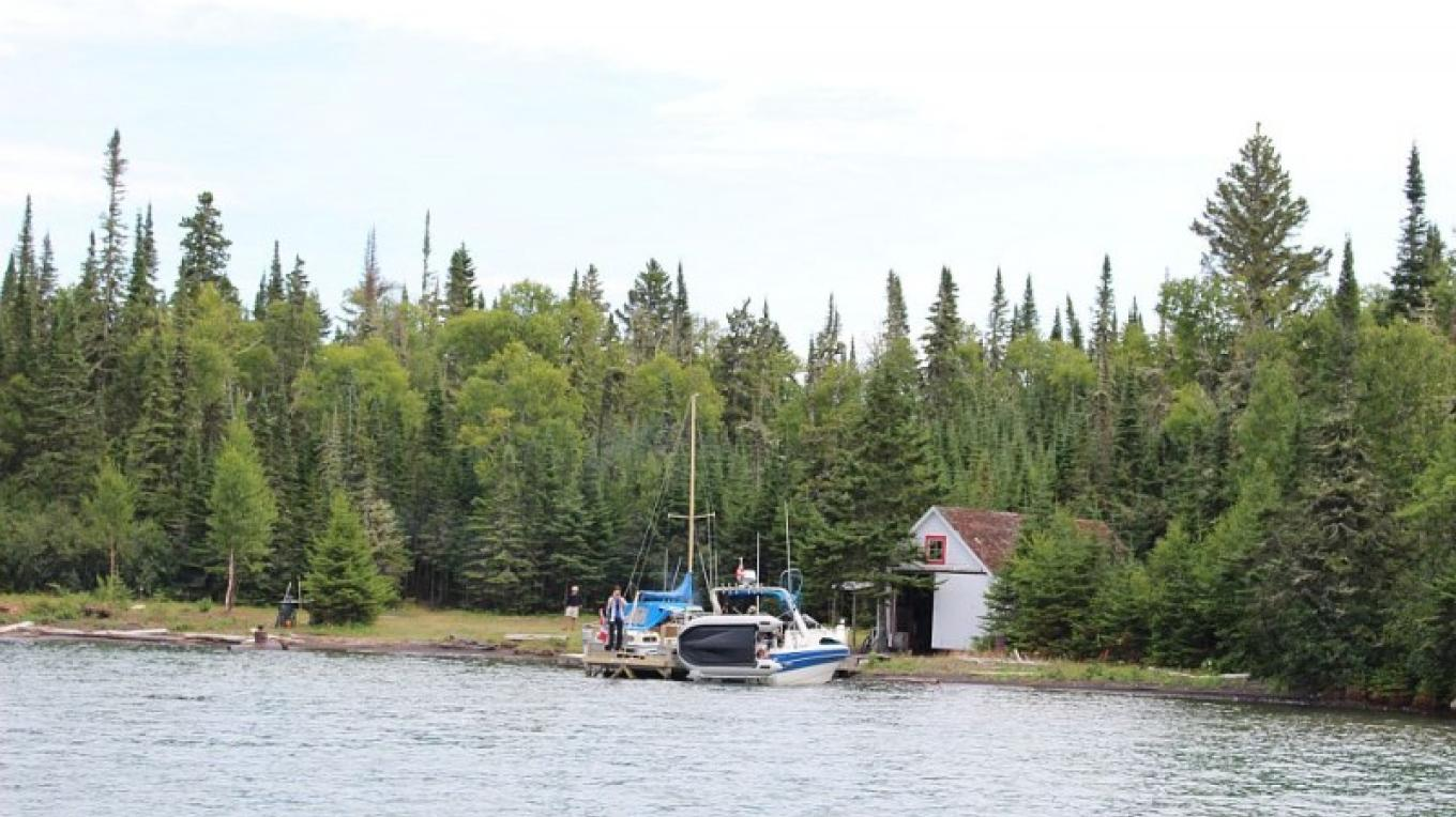 The boathouse on the north side of the island offers sailboats, power boats and kayaks a sheltered bay to access the island and also is a great camping spot for Canoeist and Kayakers. – Photo by: S. Reid