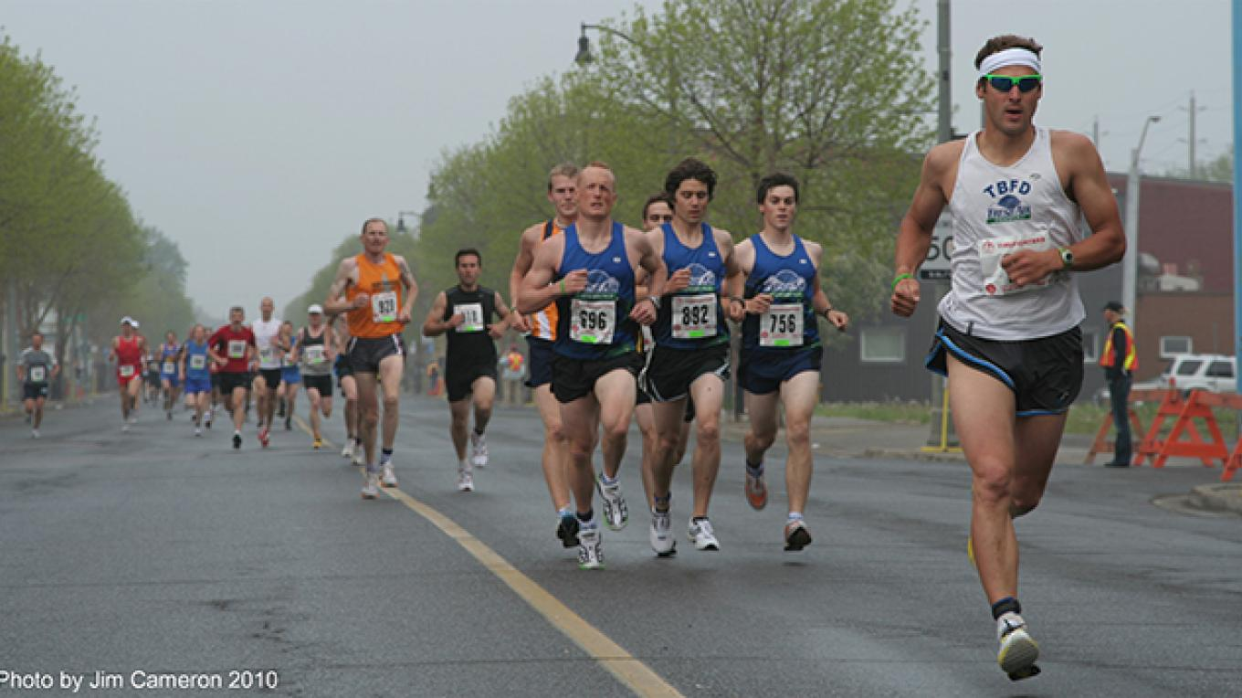 Runners on the last leg of the race about a mile out coming toward the finish at May St. – Jim Cameron - 10-Mile Road Race