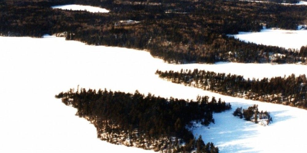 Knife Lake in winter: Isle of Pines is the arrowhead-shaped island with two small islands in center of photo.