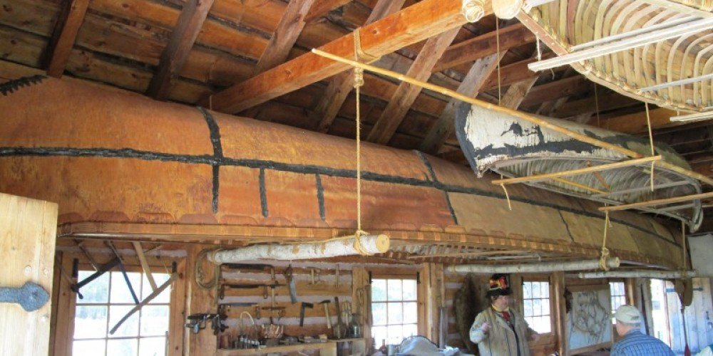 The birch bark canoe collection in the Canoe Warehouse houses perhaps the largest birch bark canoe you will see. – Beth Drost, NPS
