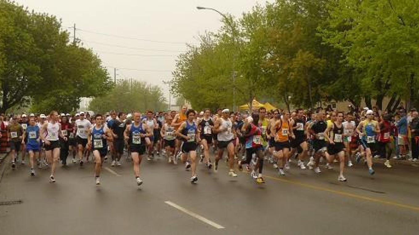 Runners line up for the start of 2010 - 100 years after the 1910 inaugural event. – Jim Cameron - 10-Mile Road Race