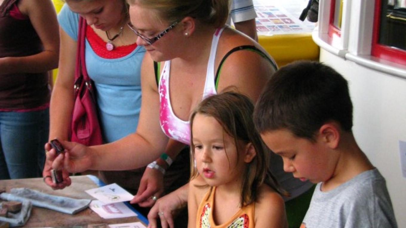 Visitors enjoying an activity table during Twin Ports Lighthouse Days. – US Army Corps of Engineers