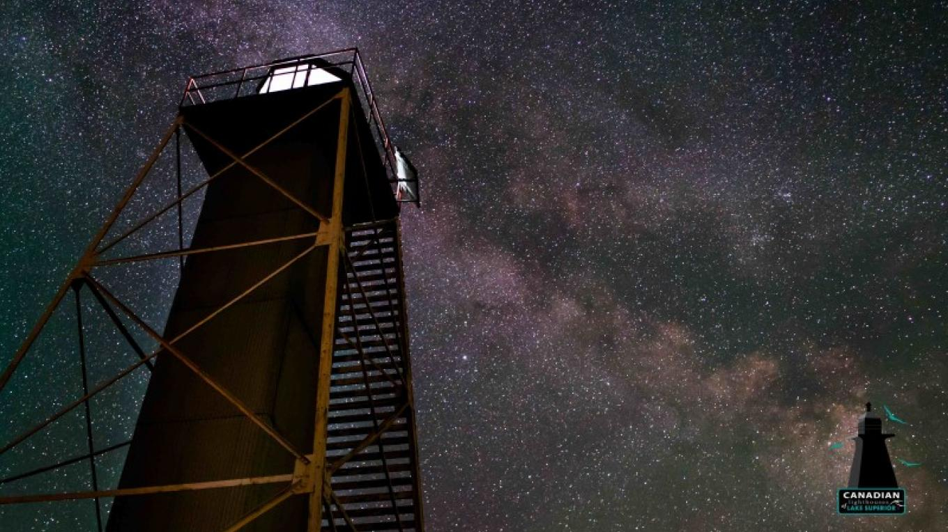 The lighthouse, now fully automated, still performs it's night duties as a navigation guide for ships and boats on Lake Superior. This image is part of the attached video on this site of a nighttime time lapse shot. – Photo by: V. Chimenti
