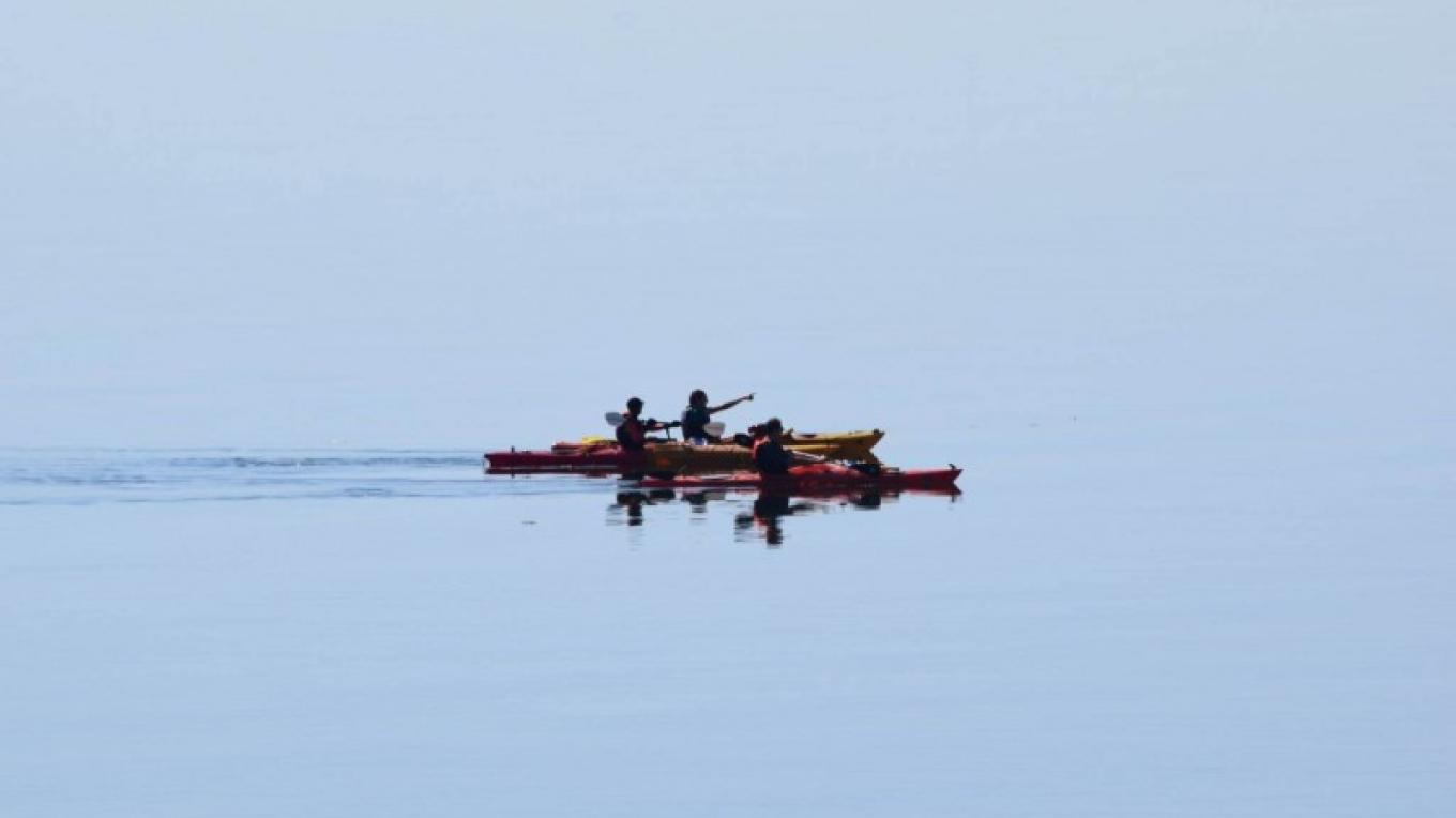 Guide Kaitlin Erpestad with tour participants on Lake Superior – Jake Boyce