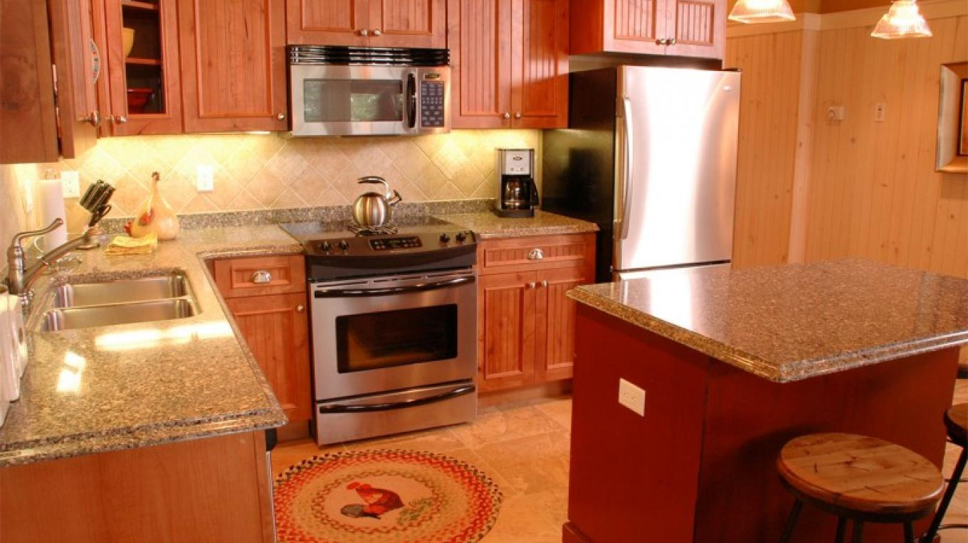 Full kitchens are available in some unit types. – Larsmont Cottages