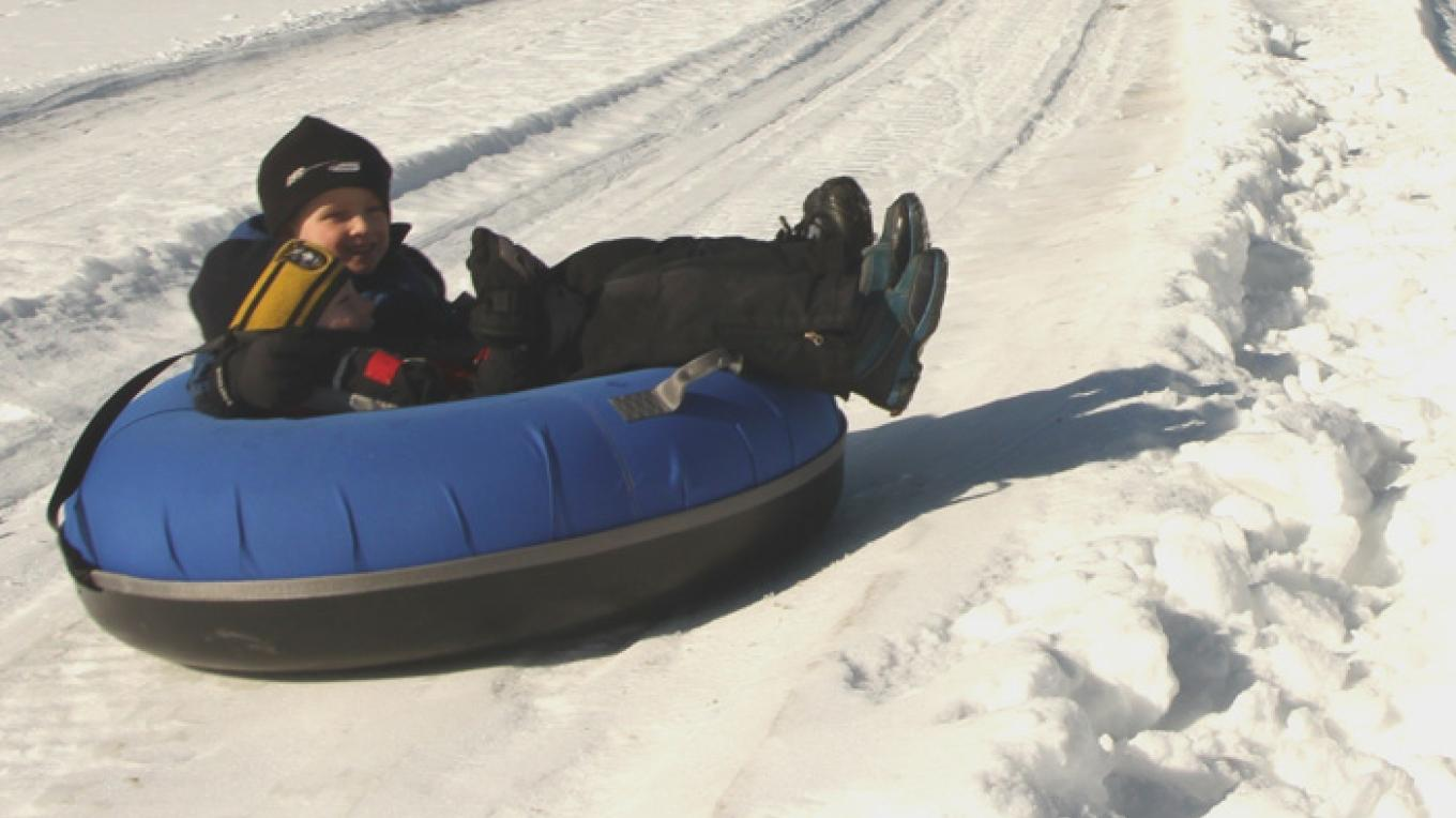 Kids will enjoy the tubing hills at the Voyageur Winter Carnival – Fort William Historical Park