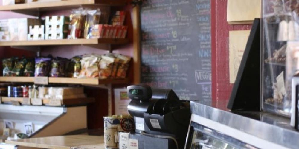 THe interior of the deli at Northern Waters Smokehaus facing the meat case and the cash register. – Mary K Tennis