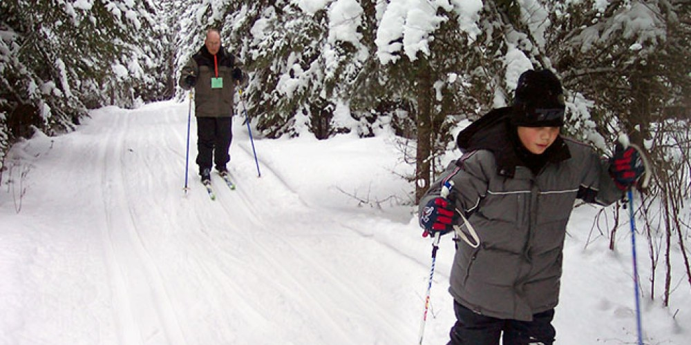 Ski, snowshoe and peer under the ice of frozen Wolf Lake. – Wolf Ridge Environmental Learning Center