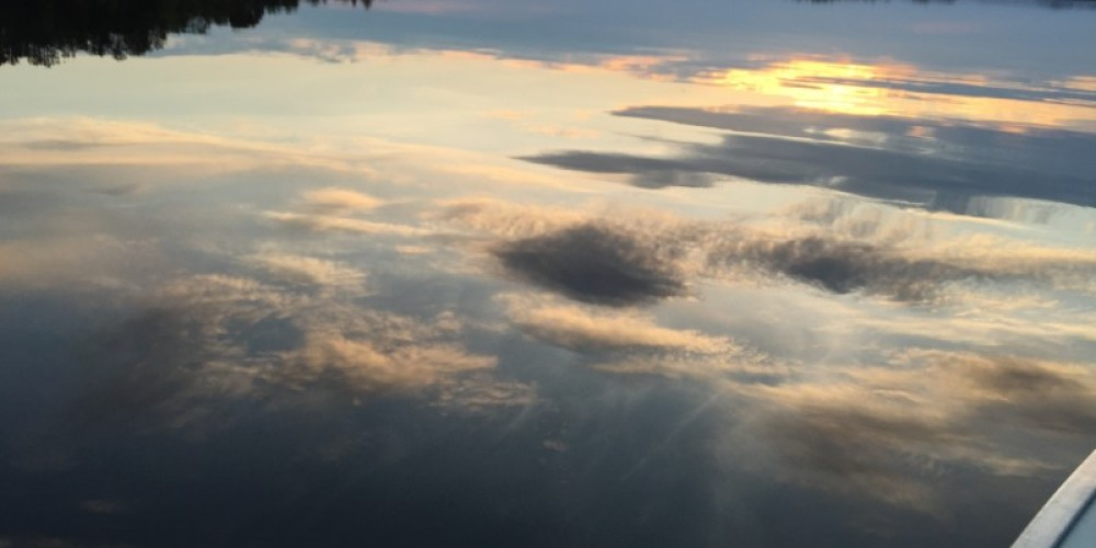 Clouds reflecting in Voyageurs National Park – Eric Johnson