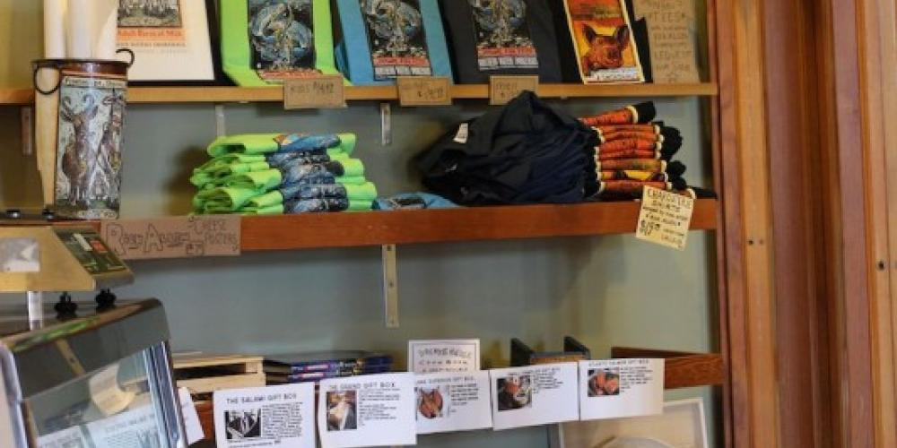 The interior of Northern Waters Smokehaus, facing the fish case and the t-shirt/poster wall. – Mary K Tennis