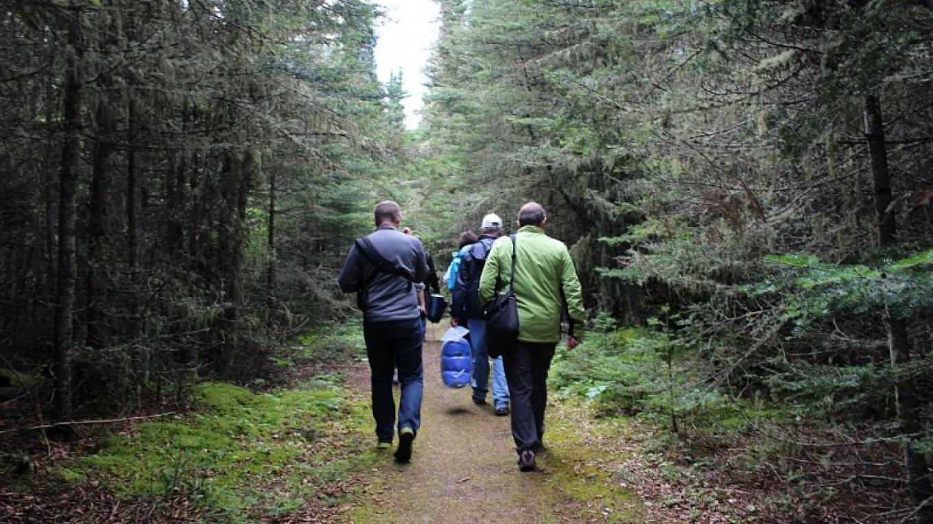From the dock on the shelter bay of the north side of the island, it is a two kilometre hike (15 min. walk) to lighthouse site. Volunteers have brushed the trail and walk is part of the experience. – Photo by: S. Reid