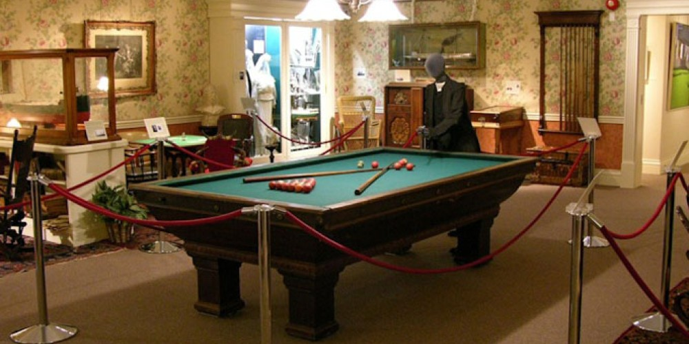 Gallery Display at Thunder Bay Museum showcasing the game of pool. – Thunder Bay Museum