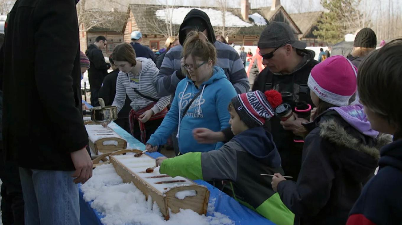Roll your own maple taffy treat at the Voyageur Winter Carnival's cabane à sucre – Fort William Historical Park
