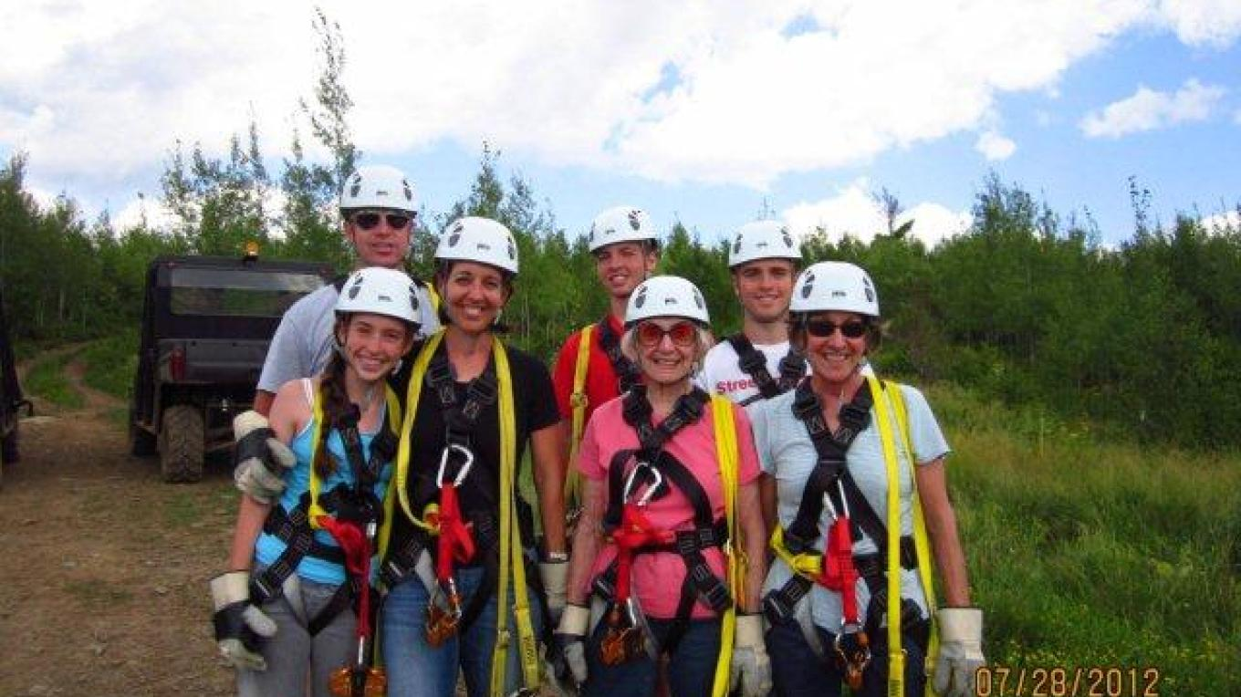 Excited group harnessed up ready to start, anchored by the senior member of the family- a 90 yr old grandmother – Gunflint Lodge staff