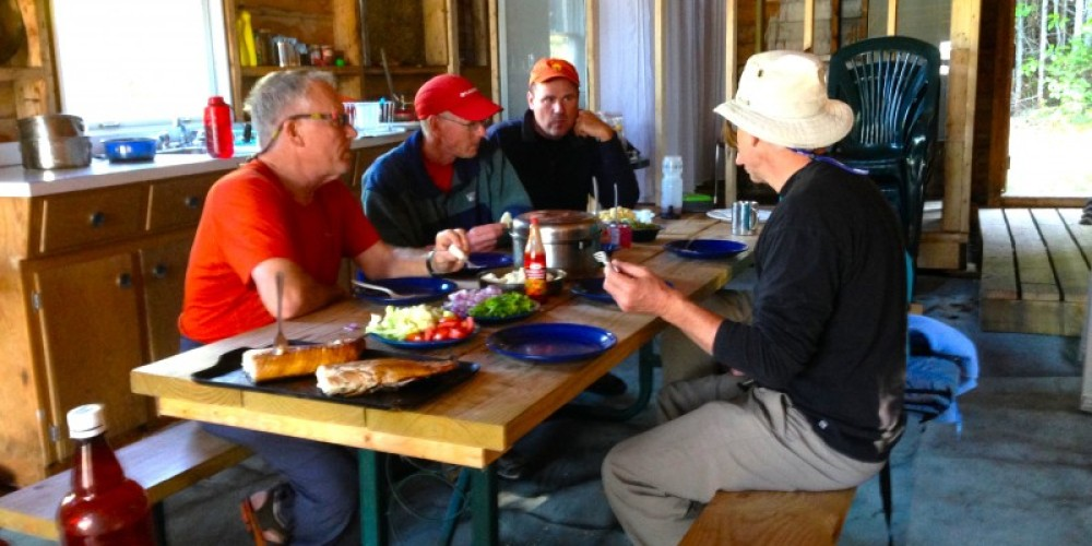 The volunteer group from the Canadian Lighthouses of Lake Superior discuss plans to preserve the history of this Lake Superior landmark. The group began upgrades to the site in 2014. – Photo by: P. Morralee