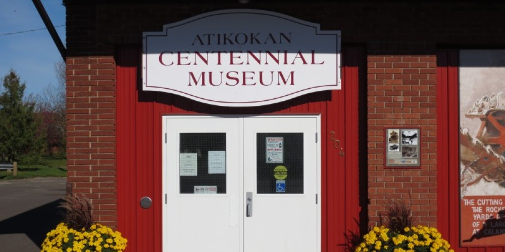 Entrance to the Atikokan Centennial Museum. Adapted reuse of the former fire station and town hall, located at the east end of Main Street and across the foot bridge from Heritage Point