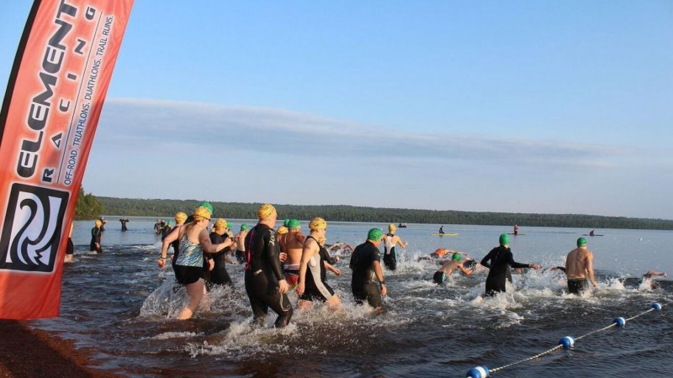 Swimmers hitting the water at start at Lake Marie Louise in Sleeping Giant Provincial Park – XTERRA Sleeping Giant