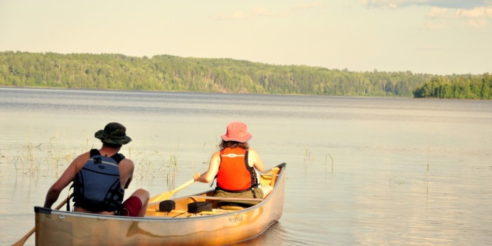 Paddling on a sunny day on Bald Eagle Lake in the BWCA. – Ely Outfitting Company