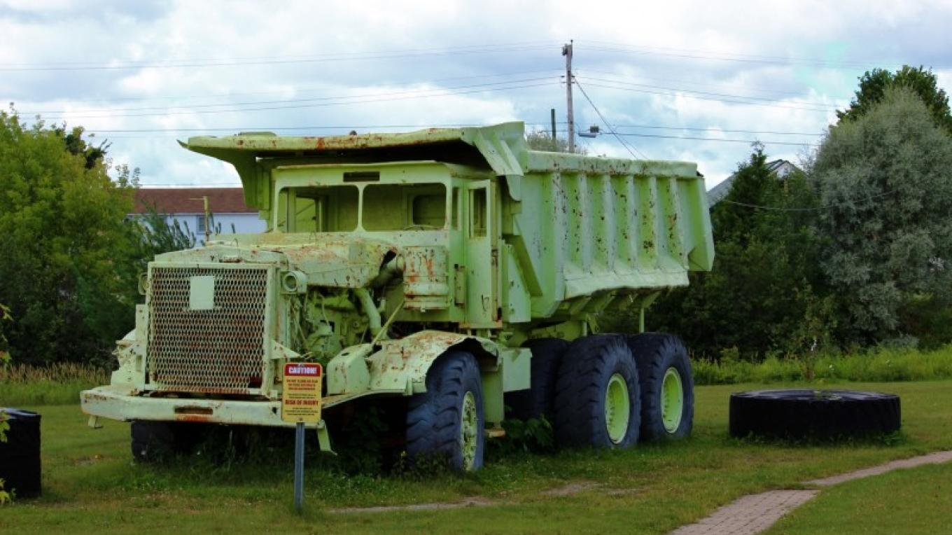 The Euclid dump truck was owned by Caland Ore Company. Built to carry 45 tons of ore in an open pit mine. Designated #6,nicknamed by its driver the Mean Machine. – Lynx Photography (Doug Strom)