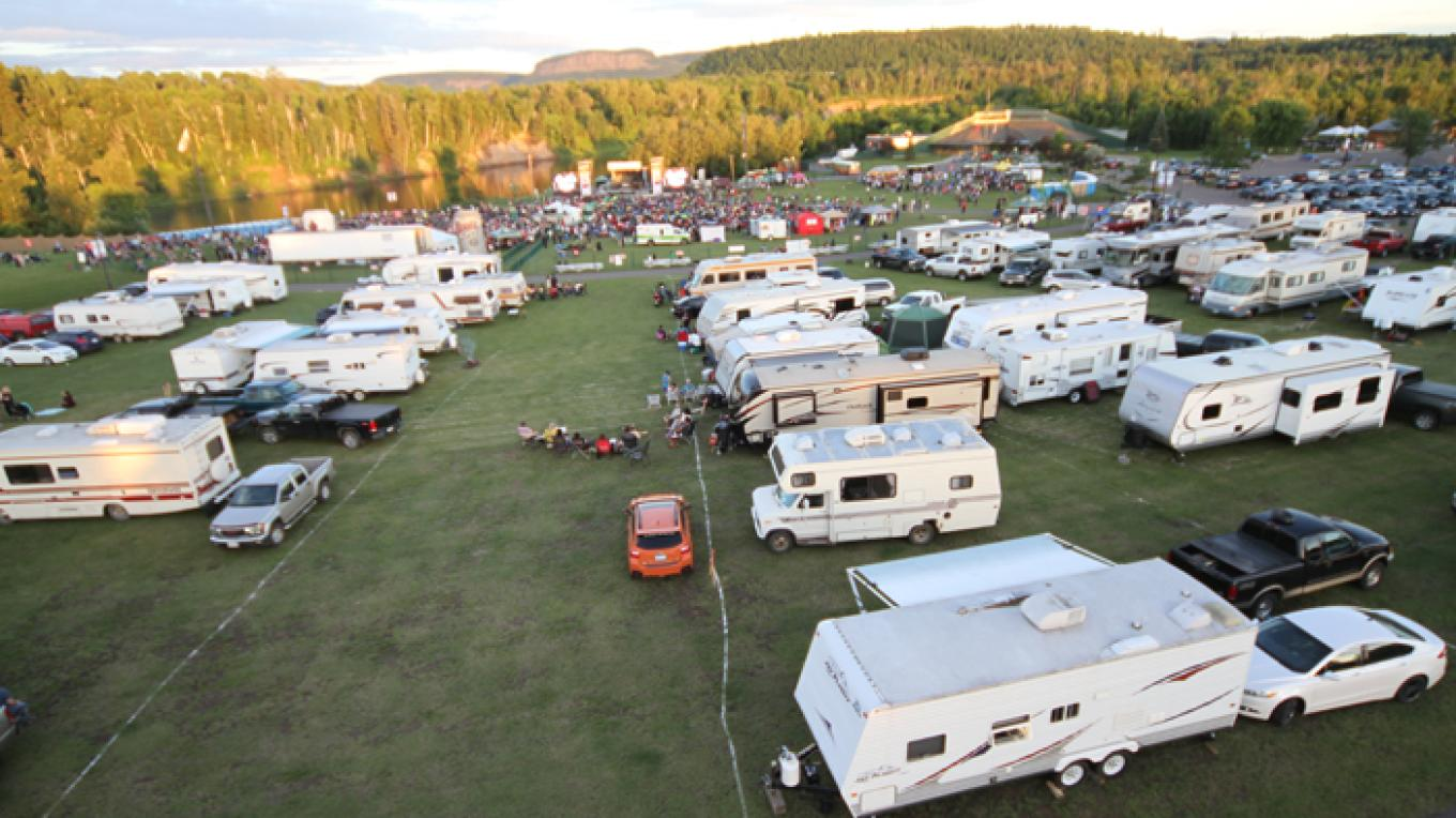 Aerial view of the spacious campground overlooking the Nor'wester mountain range – Fort William Historical Park