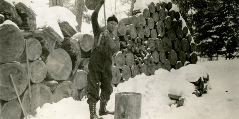 I.W. Stevens chopping wood on his island – MHS