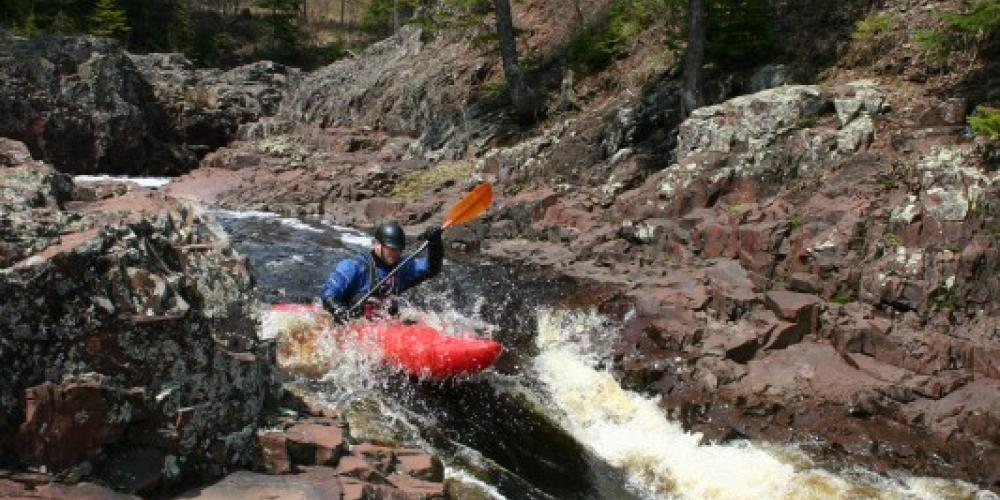 Spring kayakers on the Baptism River – Andy Fisher