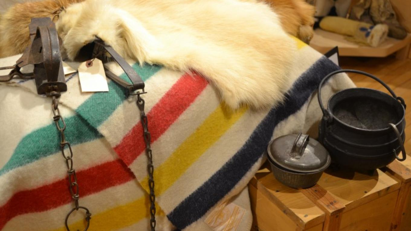 Fur Trade display featuring traps, blankets, fur pelts, and other items used for trading – Jillian Berry
