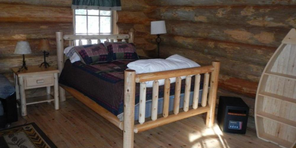 Log Cabin - Accommodations available year round adjacent to main beach - Dawson Trail Campgrounds
