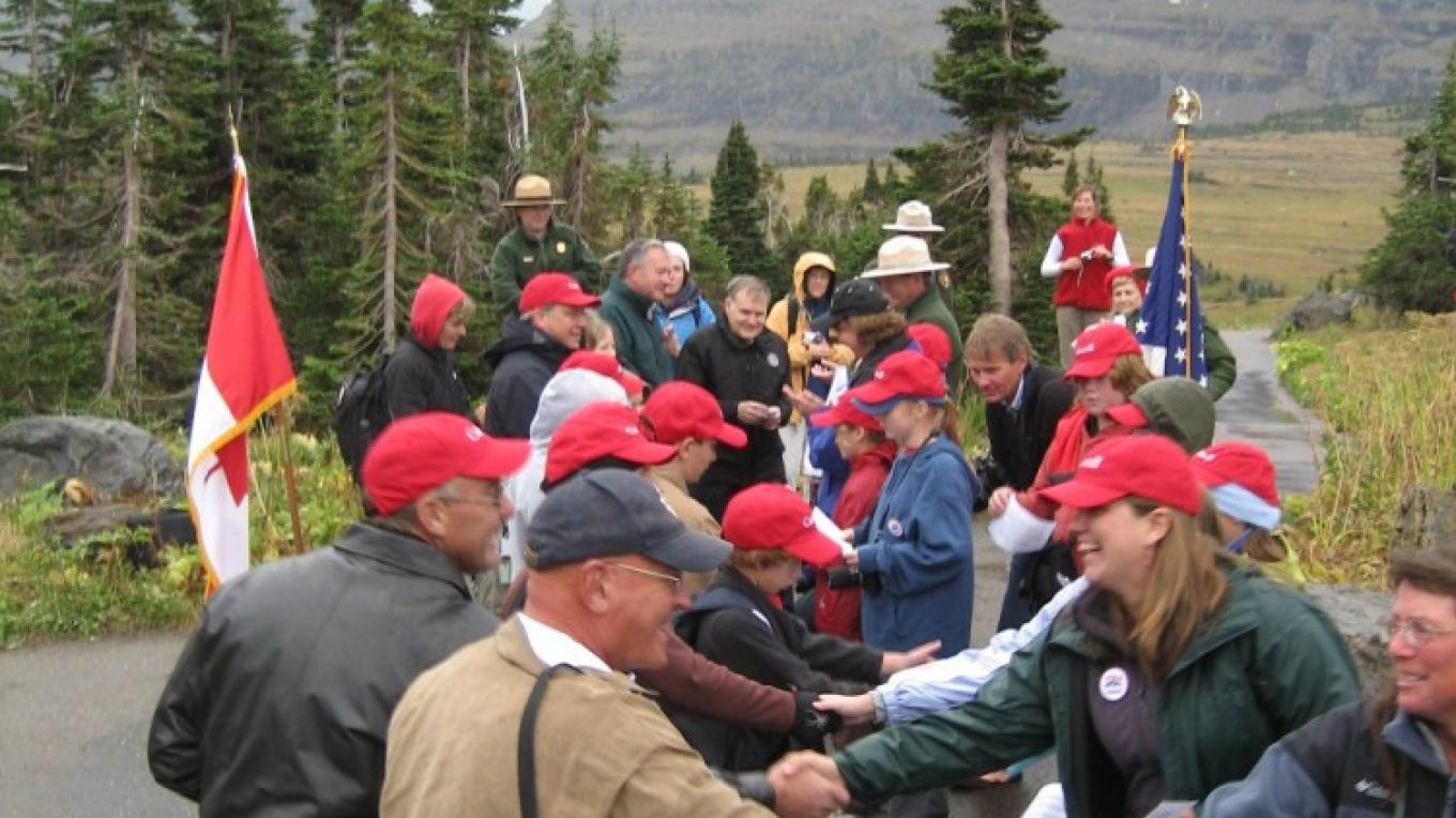Children, Rotarians, and park officials pledge enduring peace and friendship between the U.S. and Canada during the 75th anniversary of the Peace Park in 2007. – Steve Thompson