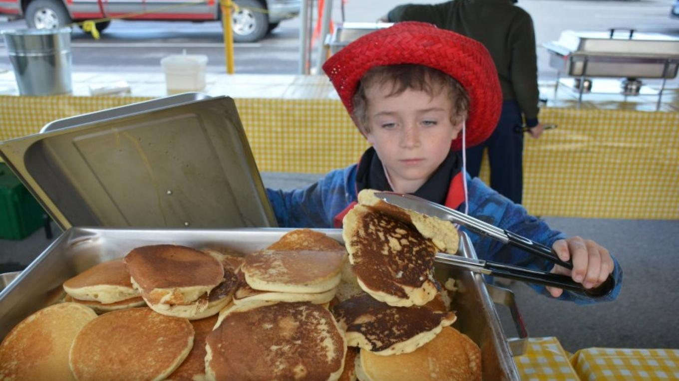 Serving up pancakes at Sam Steele Days. – The Sam Steele Society