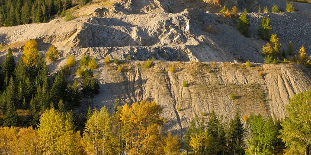 Limestone quarry looms over campground at Island Lake Provincial Recreation Area. – David Thomas