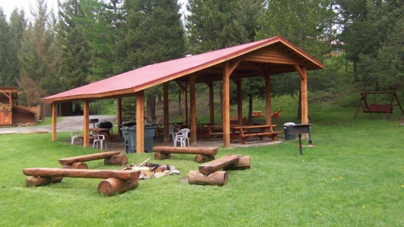 Outdoor pavilion provides all weather accommodation for your event or gathering. Campfires are held in safety pit. – Historic Tamarack Lodge and Cabins