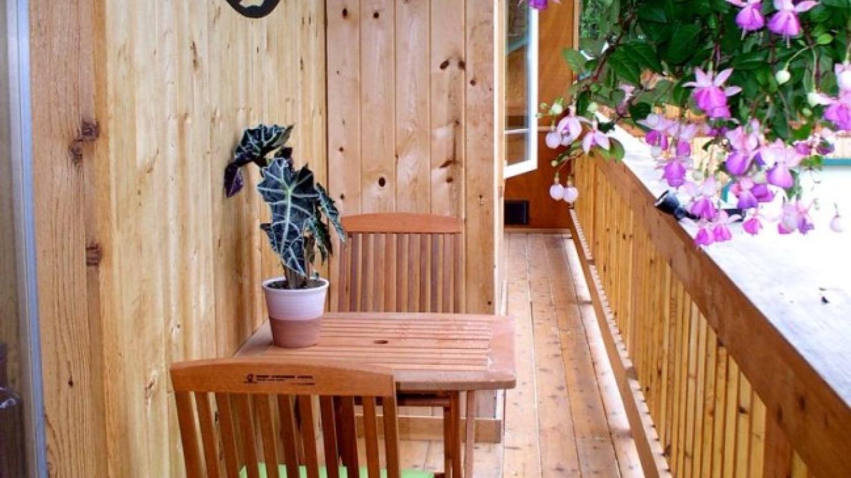 Second floor deck overlooking perennial garden. – Raven Moss