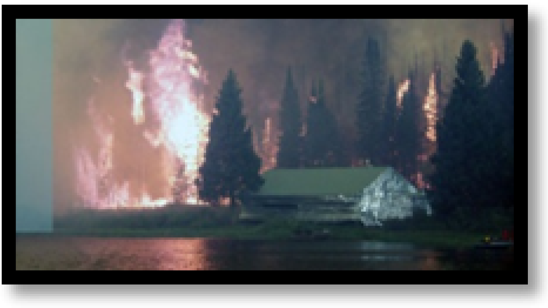 Fire threatening home